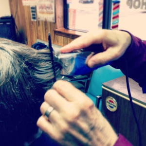 Gene cuts a customer's hair at his shop.